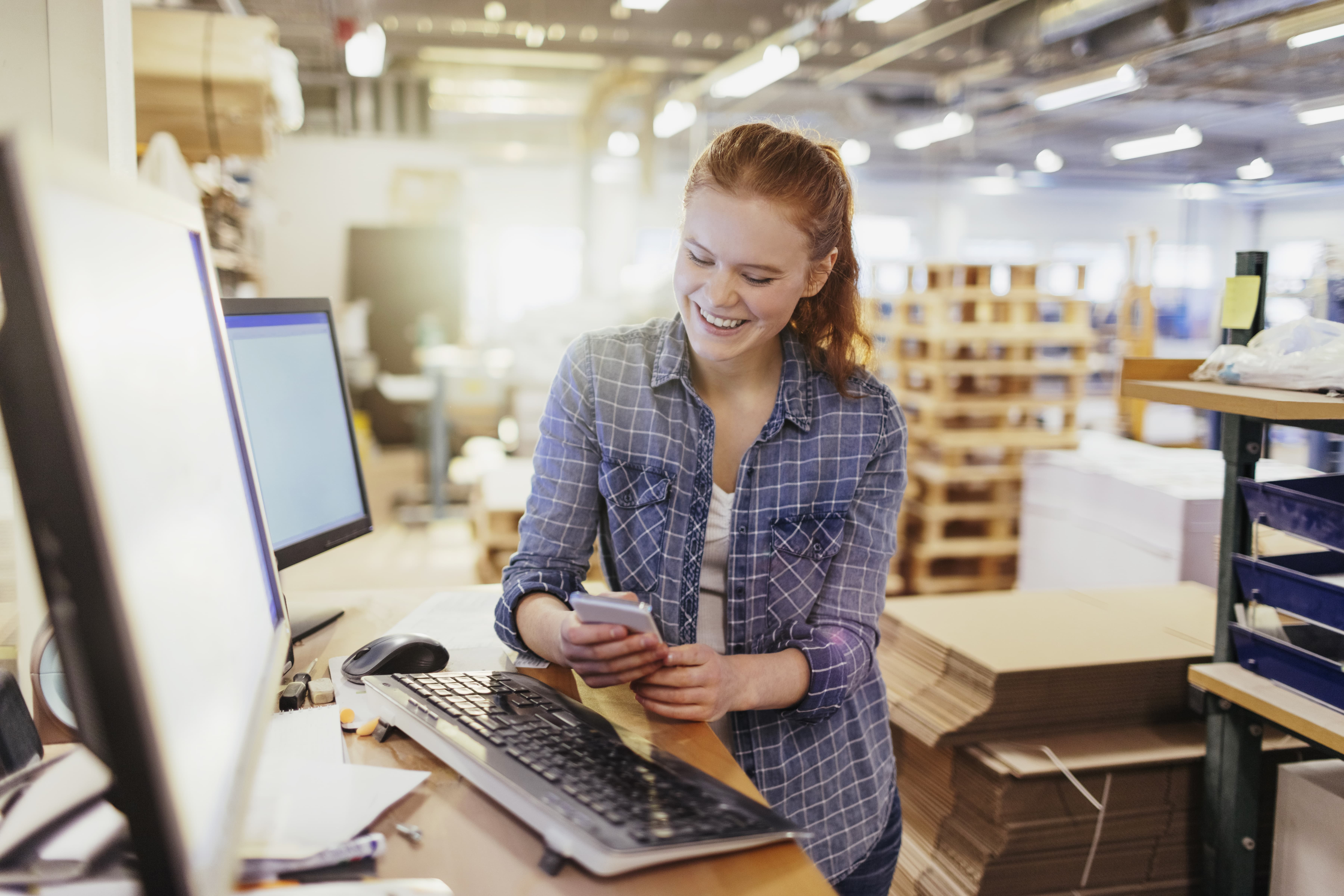 get a quote - girl at desk in warehouse-min